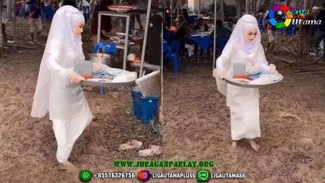 Pengantin Bereskan Piring Kotor Bekas Tamu di Hari Pernikahannya